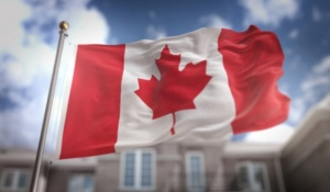 canada-flag-3d-rendering-on-blue-sky-building-background_1379-1255